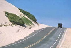 Photo of car traveling the main road as you enter Porto das Dunas